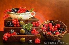 Still life with soft fruits in wooden drawers and basket.
