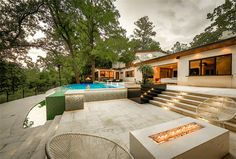 218 Pine Hollow Ln Houston, TX 77056: Photo Another Sitting area in backyard with fire pit and view of the infinity pool