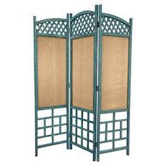 """Three-panel room divider with a blue wood frame and cotton screens.Product: Room divider    Construction Material: Kiln dried wood and cotton    Color: Blue     Features:   Curved tops arch downward from center panel   Cotton screen allows for partial light and visibility  Three panels  Two-way hinges allow for independent standing  Dimensions: 17"""" W each (panel)"""