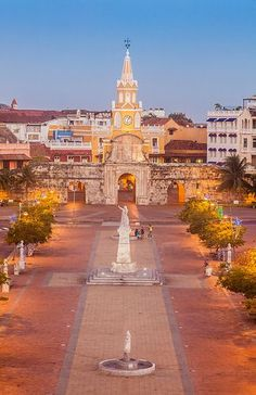 Enter the walled Old Town of Cartagena de Indias, a port city of Colombia, to see the landmark Clock Tower.