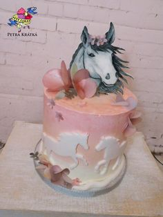 I like the idea of the light pink with the white horses (not a fan of the rest of this cake's design) Horses - http://cakesdecor.com/cakes/262549-horses | https://lomejordelaweb.es/