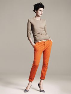 A very well put-together outfit. Orange pants! All the colors/shades in this outfit work together really well, even the belt. Heels with cropped/folded-cuff pants.