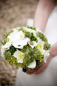 lovely succulent bouquet.this with roses yellow and red maybe?a little of grandpa at my wedding