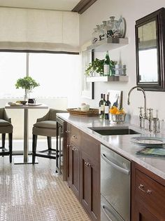 Suzie: Phoebe Howard - Galley kitchen! Brown kitchen cabinets with carrera carrara marble ...