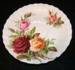 Kings Ransom plate original. The design was a result of years of work by Harold Holdcroft who said; We decided to incorporate all the ingredients we knew would be acceptable, richness of colour, softness of colour, good quality and a good value look. All these qualities are incorporated in the pattern. It has lush deep red roses, warmth from the tea roses, delicacy from the bluish pink and an overall softening off of the pattern by using a shade of soft warm green and gold stipling.
