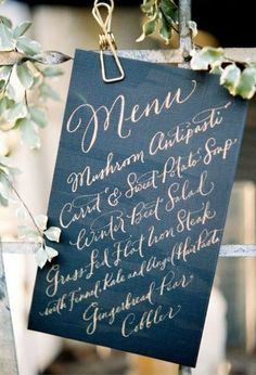 Black + Gold Menu. Love the gold painted metal clip.