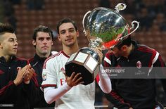 Mattia De Sciglio of AC Milan lifts the trophy following the Luigi Berlusconi Trophy at Stadio Giuseppe Meazza on November 5, 2014 in Milan, Italy. Milan Italy, Ac Milan, Luigi, November, Stock Photos, Sport, Pictures, Image, Italia