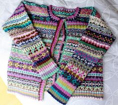 """busyhands: Fair Isle Cardigan - I love the colours and the """"asymmetry"""" of the patterning. Clever."""
