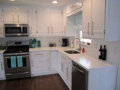 Love the white on white on white kitchen.