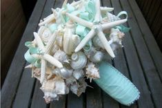 Photos of 35+ amazing beach wedding bouquets in different styles - made with details such as exotic tropical flowers, seashells, starfish and more.