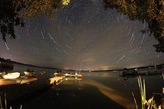 By Dan Moellering. Star trails over Pickerel Lake