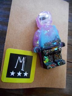 New to MorningstarCurio on Etsy: Galactic Spaceman Minifig with googly eye and faux opal purple blue and black novelty brooch #16212 (Clive) (8.00 USD)