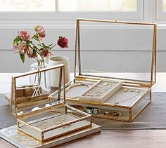 A fine filigree pattern on the gold trim adds glimmer and texture to our boxes. They're ideal for displaying favorite jewelry or small mementos, and make a w...