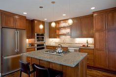 Beautiful Beach wood cabinets with open shelving with lighting