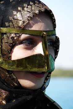 Closeup of the Burqa, a golden scarf covering the face, which is part of the traditional Bandari costume of Southern Iran.
