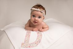 Lovely swaddling blanket with oversized embroidered Liberty print initial.