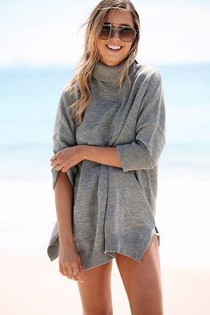 The Marley Knit Dress is made from a grey marl knit with slight stretch and features a high turtleneck, long sleeves and a thick rib detailing along the hem and sleeves. Panel detail through the centre front and back. Can be worn as a dress or an oversized top. By Sabo Skirt.