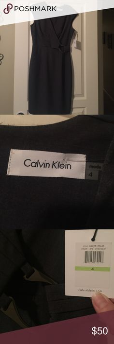 Calvin Klein gray dress NWT CK charcoal gray dress. Beautiful gun metal detail in front. Zips up in the back. I've had in my closet for a while and it never got worn. Cleaning out my closet. Calvin Klein Dresses Midi
