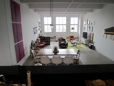 loft living, industrial space, view of living area, work space, dining table, living room