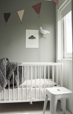 so adorable! baby nursery/toddler room with chalk board wall for him/her to write on!