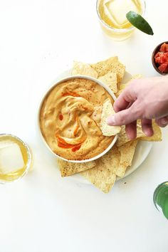 Cashew- Free Vegan Queso Dip! Made with a secret ingredient to keep it creamy, velvety and totally cashew, soy, gluten and dairy free! #vegan