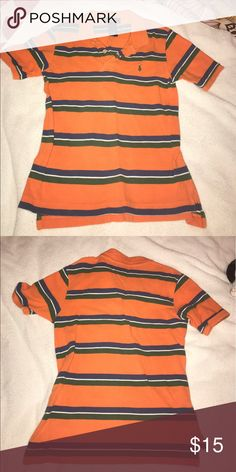 Striped polo shirt Ralph Lauren In great condition. Nice pattern of strips and nice colors of orange, navy blue and green. Polo by Ralph Lauren Shirts & Tops Polos
