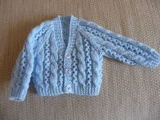 Hand knitted blue cardigan for newborn baby boy