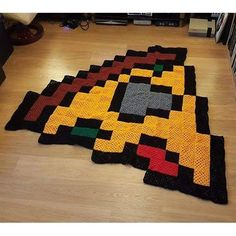 Pizza slice pixel crochet  blanket by Craft Invaders                                                                                                                                                     More