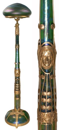 "Art Nouveau floor lamp with female masks, glass attributed to Loetz, metalwork designed by Gustav Gurschner, 5'-3"" H."