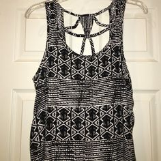Cute Tribal Tank Top Tribal patterned low-high tank top. Never worn! Forever 21 Tops Tunics