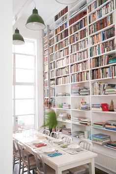 wall of books in dining area