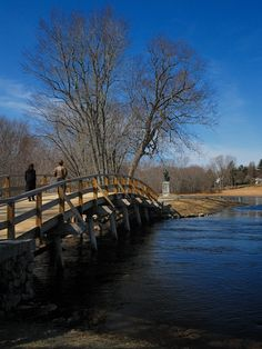 """Old North Bridge, Historical Site of Battle of Lexington, Concord, Massachusetts Ralph Waldo Emerson, in his """"Concord Hymn"""", described the first shot fired by the Patriots at the North Bridge as the """"shot heard 'round the world."""""""