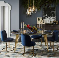 West Elm dinning table and chairs. Obsessed with navy blue and gold