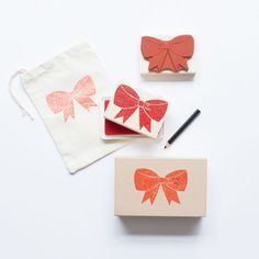 Need a quick and easy ribbon for your gift? Just use the Custom Gift Bow Stamp Activity Kit. This bow stamp can be used for decorating wrapping paper or making gift tags! so versatile! Kit includes 1 natural rubber stamp mounted on a maple block, 1 colored pencil and one multipurpose ink pad.