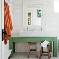 the iron gate: beveled wood mirror, custom built-in bathroom