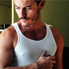 Image result for images of luke evans with nipple