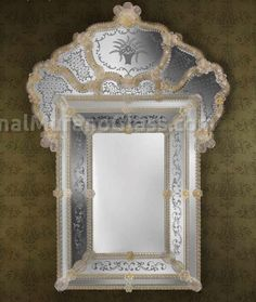 Venetian mirror, handcrafted, made in Murano.The mirror consists of 38 flowers and canes curls,with glass fused with 24kt gold,andwooden frame. The art work is designed, realized and assempled by our mirror artisans, glass masters, carpenters, with attention of the details. It is not made industrially, but according to the ancient venetian tradition of the mirrors makers. For a modern designed style, vintage, it's possible to customize colors of flowers and canes, by contacting us. Th...