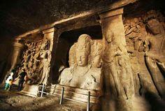 Tourists look at carvings of Hindu God Siva - Anuruddha Lokuhapuarachchi/Reuters