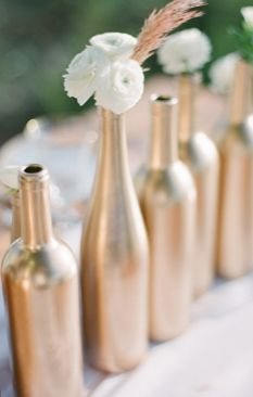 Gold Spray painted bottles make for fab vases! (Photo by Jessica Lorren Organic Photography on Every Last Detail).