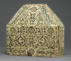 Reliquary from the tenth century, displays a masterful treatment of ivory where the surface is modeled by incision and relief carving while the background is pierced through. In the Middle Ages, it was common for ivory-covered reliquaries to display scenes of the life of the saint, whose remains were held within the container, but in this example, the ivory displays more purely decorative imagery.