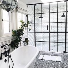 What's your stress reliever? Taking a nice bath is always a great idea! With this amazing shower and bathroom layout you can have the perfect escape after a long day. We love the black and white tiling that gives it an older look but the shower has a very modern style at the same time. Check it out!  #luxury #love #modern #realestate #noframe#cozy #modern #contemporary#lessismore #design #homedesign #photoofday #luxury#buildings #sky #love #culture #architecture #arch_more…