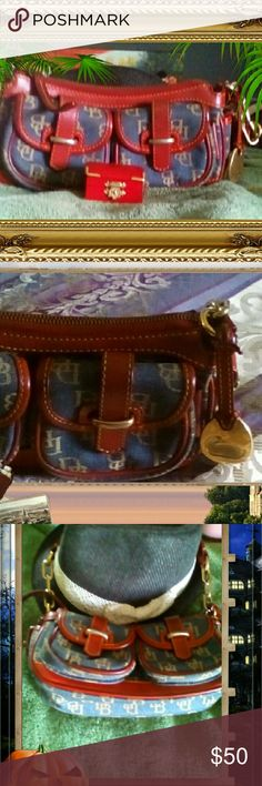 Dooney and Bourke Outback  Final Sale Vintage Dooney and Bourke Outback shoulder bag. The purse is in excellent condition but the monogram of the Dooney and Bourke Gold Duck tassel has some fading on it and the chain metal on the shoulder straps show some small time of wear. The purse is beautiful condition on the outside. It has an inside zipper and front pockets open up. Dooney & Bourke Bags Shoulder Bags