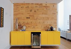 Accent Wall created with wood reused from wine boxes