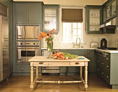 Darker colors can really open up a room in a smaller-sized kitchen. Try painting the cabinets a darker color, such as Benjamin Moore's Great Barrington Green (see next slide).
