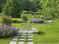 Rhythmic sequences of paths and plantings in a garden on New York's Long Island. Designed by Edmund Hollander and Maryanne Connelly of New York firm Edmund Hollander Design.