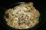 Chicken Fried Rice + slow cooker! Throw left-overs in the pot and crack an egg on top of it all and stir it all up and let it go!