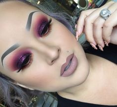 I love her matte grey / nude toned lipstick!! The bold colored eye shadow is nicely blended as well