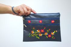 A personal favourite from my Etsy shop https://www.etsy.com/sg-en/listing/472635422/boho-floral-clutch-bag-embroidery