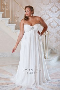 """Never fear all you #brides to be! Sydney's Closet is bringing back the """"Promise Me"""" #Wedding Dress. This #plussize strapless, chiffon gown has a gorgeous rhinestone and pearl encrusted motif. The pleated empire waist has a sweep train and it really flows. This informal gown is perfect for casual ceremonies at the beach, your little white chapel or even a beautiful outdoor wedding.  http://www.sydneyscloset.com/sydneys-closet/5023/"""