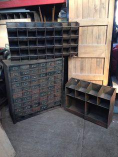 Vintage industrial job lot. Old workshop storage drawers, skips, pigeon holes.